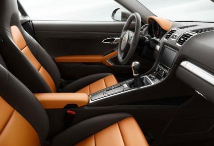 بورش تكشف النقاب عن سيارتي  Cayman وCayman أس 2014